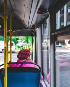 Woman in a bus looking outside the window