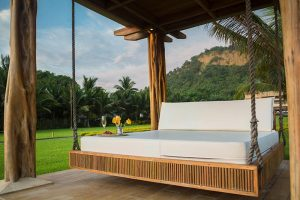 Mattress in a wooden frame in a beautiful location