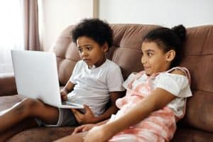 Siblings: Brother and sister using a laptop