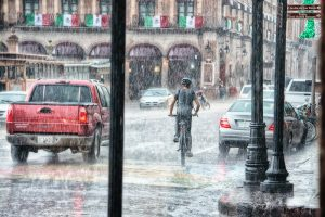 Riding bicycle on a rainy day
