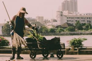 Street cleaner with broom and cart