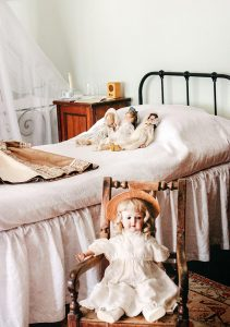 Classic dolls on a bed