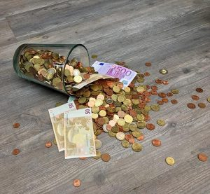 Coins and banknotes scattered on a table