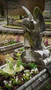 Grey concrete statue at the tomb