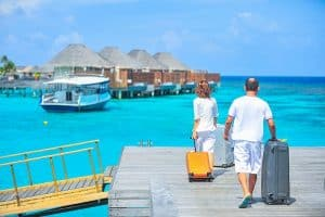 Man and woman on holiday with suitcases