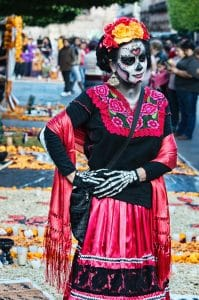 Women in a dress at a festival of Death in Mexico
